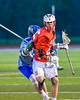 Baldwinsville Bees Brandon Kohutanich (25) cradling the ball against the Cicero-North Syracuse Northstars in Section III Boys Lacrosse action at the Bragman Stadium in Cicero, New York on Thursday, May 12, 2016.  Baldwinsville won 7-6 in OT.