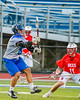 Cicero-North Syracuse Northstars Drew Flack (8) passes the ball over Baldwinsville Bees Patrick Delpha (11) in Section III Boys Lacrosse action at the Bragman Stadium in Cicero, New York on Thursday, May 12, 2016.  Baldwinsville won 7-6 in OT.