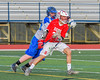 Baldwinsville Bees Peter Fiorni III (13) protects the ball from a Cicero-North Syracuse Northstars defender in Section III Boys Lacrosse action at the Bragman Stadium in Cicero, New York on Thursday, May 12, 2016.  Baldwinsville won 7-6 in OT.