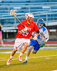 Baldwinsville Bees Kyle Pelcher (29) runs past a Cicero-North Syracuse Northstars defender in Section III Boys Lacrosse action at the Bragman Stadium in Cicero, New York on Thursday, May 12, 2016.  Baldwinsville won 7-6 in OT.
