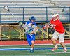 Baldwinsville Bees Charlie Bertrand (6) checks Cicero-North Syracuse Northstars Mike Hughes (40) in Section III Boys Lacrosse action at the Bragman Stadium in Cicero, New York on Thursday, May 12, 2016.  Baldwinsville won 7-6 in OT.