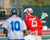 Baldwinsville Bees Brandon Kohutanich (25) lining up a shot around Cicero-North Syracuse Northstars Nick Ricardi (10) in Section III Boys Lacrosse action at the Bragman Stadium in Cicero, New York on Thursday, May 12, 2016.  Baldwinsville won 7-6 in OT.