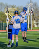 Cicero-North Syracuse Northstars Gavin Brown (19) and Tom Flynn (6) during player introductions before playing the Baldwinsville Bees in a Section III Boys Lacrosse game at the Bragman Stadium in Cicero, New York on Thursday, May 12, 2016.