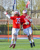 Baldwinsville Bees Brandon Kohutanich (25) and goalie Riley Smith (35) during player introductions before playing the Cicero-North Syracuse Northstars in a Section III Boys Lacrosse game at the Bragman Stadium in Cicero, New York on Thursday, May 12, 2016.