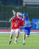 Baldwinsville Bees Dillon Darcangelo (10) protecting the ball from Cicero-North Syracuse Northstars Nate Scarlata (4) in Section III Boys Lacrosse action at the Bragman Stadium in Cicero, New York on Thursday, May 12, 2016.  Baldwinsville won 7-6 in OT.
