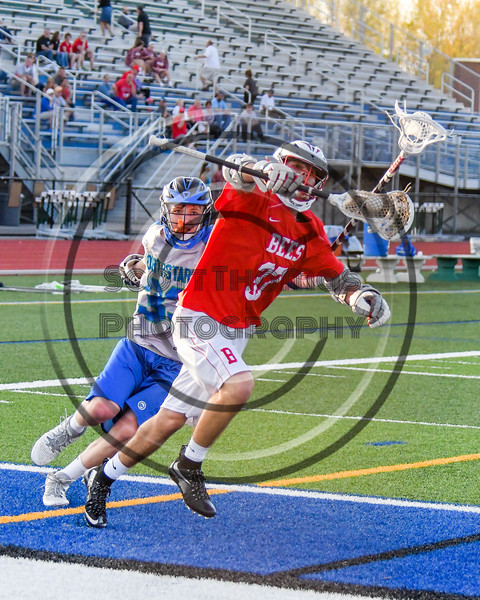 Baldwinsville Bees Cole Peters (37) wims past Cicero-North Syracuse Northstars Sutter Donegan (33) in Section III Boys Lacrosse action at the Bragman Stadium in Cicero, New York on Thursday, May 12, 2016.  Baldwinsville won 7-6 in OT.