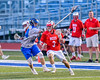 Baldwinsville Bees Ryan ingerson (3) protecting the ball against a Cicero-North Syracuse Northstars defender in Section III Boys Lacrosse action at the Bragman Stadium in Cicero, New York on Thursday, May 12, 2016.  Baldwinsville won 7-6 in OT.