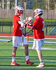 Baldwinsville Bees Ryan Gebhardt (20) congratulates Peter Fiorni III (13) for his goal agianst the Cicero-North Syracuse Northstars in Section III Boys Lacrosse action at the Bragman Stadium in Cicero, New York on Thursday, May 12, 2016.  Baldwinsville won 7-6 in OT.