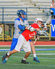 Baldwinsville Bees Cole Peters (37) gets the ball knocked out of his stick by a Cicero-North Syracuse Northstars defender in Section III Boys Lacrosse action at the Bragman Stadium in Cicero, New York on Thursday, May 12, 2016.  Baldwinsville won 7-6 in OT.