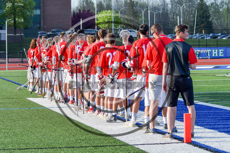 Baldwinsville Bees during the National Anthem before playing the Cicero-North Syracuse Northstars in a Section III Boys Lacrosse game at the Bragman Stadium in Cicero, New York on Thursday, May 12, 2016.