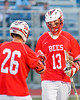 Baldwinsville Bees Connor Smith (26) congratulates Peter Fiorni III (13) for his goal against the Cicero-North Syracuse Northstars in Section III Boys Lacrosse action at the Bragman Stadium in Cicero, New York on Thursday, May 12, 2016.  Baldwinsville won 7-6 in OT.