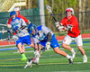 Cicero-North Syracuse Northstars Drew Flack (8) scooops up a ground ball as Baldwinsville Bees Ryan ingerson (3) gives chase in Section III Boys Lacrosse action at the Bragman Stadium in Cicero, New York on Thursday, May 12, 2016.  Baldwinsville won 7-6 in OT.