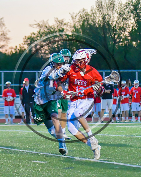Baldwinsville Bees Peter Fiorni III (13) driving against the Fayetteville-Manlius Hornets in Section III Boys Lacrosse action at the Fayetteville-Manlius High School in Manlius, New York on Wednesday, May 18, 2016.  Fayetteville-Manlius won 9-8.