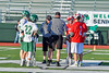 Baldwinsville Bees and Fayetteville-Manlius Hornets captains meet with game officials before a Section III Boys Lacrosse game at the Fayetteville-Manlius High School in Manlius, New York on Wednesday, May 18, 2016.