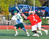 Fayetteville-Manlius Hornets Tyler Papa (14) protects the ball from Baldwinsville Bees defender John Petrelli (33) in Section III Boys Lacrosse action at the Fayetteville-Manlius High School in Manlius, New York on Wednesday, May 18, 2016.  Fayetteville-Manlius won 9-8.