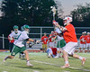 Baldwinsville Bees Charlie Bertrand (6) passes the ball over Fayetteville-Manlius Hornets defenders in Section III Boys Lacrosse action at the Fayetteville-Manlius High School in Manlius, New York on Wednesday, May 18, 2016.  Fayetteville-Manlius won 9-8.