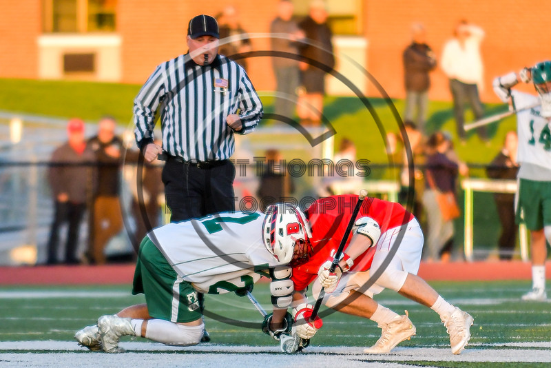 Baldwinsville Bees Patrick Delpha (11) faces off against Fayetteville-Manlius Hornets Tommy Ryu (22) in Section III Boys Lacrosse action at the Fayetteville-Manlius High School in Manlius, New York on Wednesday, May 18, 2016.  Fayetteville-Manlius won 9-8.