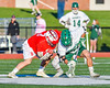 Fayetteville-Manlius Hornets Tommy Ryu (22) wins a face-off from Baldwinsville Bees Ryan ingerson (3) in Section III Boys Lacrosse action at the Fayetteville-Manlius High School in Manlius, New York on Wednesday, May 18, 2016.  Fayetteville-Manlius won 9-8.