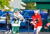 Baldwinsville Bees David Steria (14) checks Fayetteville-Manlius Hornets Dan Burnam (23) in Section III Boys Lacrosse action at the Fayetteville-Manlius High School in Manlius, New York on Wednesday, May 18, 2016.  Fayetteville-Manlius won 9-8.