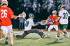 Fayetteville-Manlius Hornets goalie Ryan Boshart (28) makes a save on Baldwinsville Bees Ryan Gebhardt (20) in Section III Boys Lacrosse action at the Fayetteville-Manlius High School in Manlius, New York on Wednesday, May 18, 2016.  Fayetteville-Manlius won 9-8.