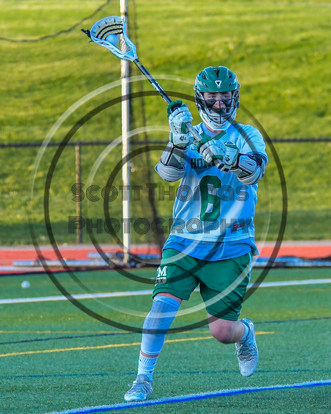 Fayetteville-Manlius Hornets Mac Fish (6) looking to make a play against the Baldwinsville Bees in Section III Boys Lacrosse action at the Fayetteville-Manlius High School in Manlius, New York on Wednesday, May 18, 2016.  Fayetteville-Manlius won 9-8.