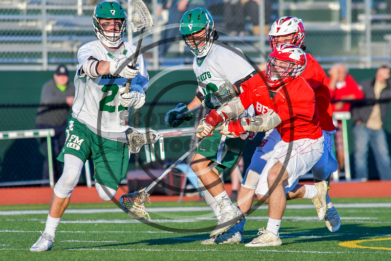 Fayetteville-Manlius Hornets Owen Penoyer (21) gets the ball against the Baldwinsville Bees in Section III Boys Lacrosse action at the Fayetteville-Manlius High School in Manlius, New York on Wednesday, May 18, 2016.  Fayetteville-Manlius won 9-8.