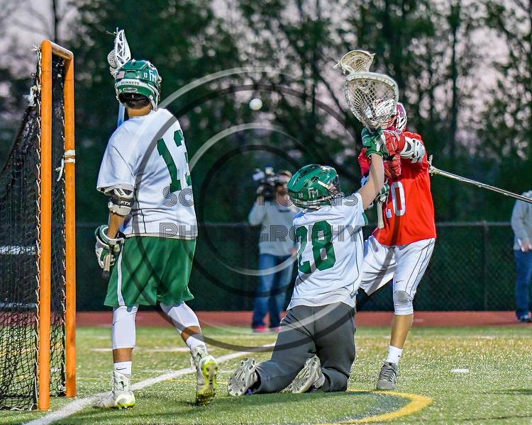 Baldwinsville Bees Ryan Gebhardt (20) scores over Fayetteville-Manlius Hornets goalie Ryan Boshart (28) in Section III Boys Lacrosse action at the Fayetteville-Manlius High School in Manlius, New York on Wednesday, May 18, 2016.  Fayetteville-Manlius won 9-8.