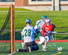 Baldwinsville Bees Ryan Gebhardt's (20) shot is stopped by Fayetteville-Manlius Hornets goalie Ryan Boshart (28) in Section III Boys Lacrosse action at the Fayetteville-Manlius High School in Manlius, New York on Wednesday, May 18, 2016.  Fayetteville-Manlius won 9-8.