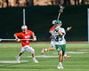 Fayetteville-Manlius Hornets Greg Zogby (33) passes the ball up field against the Baldwinsville Bees in Section III Boys Lacrosse action at the Fayetteville-Manlius High School in Manlius, New York on Wednesday, May 18, 2016.  Fayetteville-Manlius won 9-8.