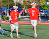 Baldwinsville Bees Ryan Gebhardt (20) congratulates Charlie Bertrand (6) on his goal agains the Fayetteville-Manlius Hornets in Section III Boys Lacrosse action at the Fayetteville-Manlius High School in Manlius, New York on Wednesday, May 18, 2016.  Fayetteville-Manlius won 9-8.