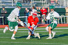 Fayetteville-Manlius Hornets Owen Penoyer (21) scoops up the ball against Baldwinsville Bees Ryan ingerson (3) in Section III Boys Lacrosse action at the Fayetteville-Manlius High School in Manlius, New York on Wednesday, May 18, 2016.  Fayetteville-Manlius won 9-8.