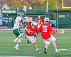 Fayetteville-Manlius Hornets Tommy Angelicola (13) avoids a check by Baldwinsville Bees Dillon Darcangelo (10) in Section III Boys Lacrosse action at the Fayetteville-Manlius High School in Manlius, New York on Wednesday, May 18, 2016.  Fayetteville-Manlius won 9-8.