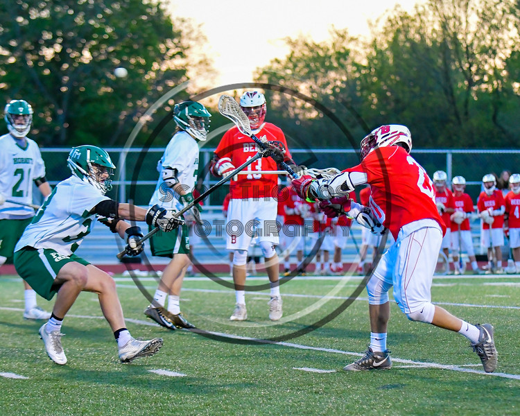 Baldwinsville Bees Ryan Gebhardt (20) fires in a goal against the Fayetteville-Manlius Hornets in Section III Boys Lacrosse action at the Fayetteville-Manlius High School in Manlius, New York on Wednesday, May 18, 2016.  Fayetteville-Manlius won 9-8.