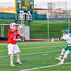 Baldwinsville Bees Connor Smith (26) passesthe ball over a  Fayetteville-Manlius Hornets defender in Section III Boys Lacrosse action at the Fayetteville-Manlius High School in Manlius, New York on Wednesday, May 18, 2016.  Fayetteville-Manlius won 9-8.