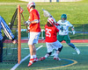 Fayetteville-Manlius Hornets Luke Hamel (1) scores past Baldwinsville Bees goalie Riley Smith (35) in Section III Boys Lacrosse action at the Fayetteville-Manlius High School in Manlius, New York on Wednesday, May 18, 2016.  Fayetteville-Manlius won 9-8.