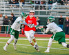 Baldwinsville Bees Ryan Gebhardt (20) gets checked by two Fayetteville-Manlius Hornets players in Section III Boys Lacrosse action at the Fayetteville-Manlius High School in Manlius, New York on Wednesday, May 18, 2016.  Fayetteville-Manlius won 9-8.