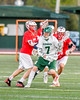 Fayetteville-Manlius Hornets James Rettinger (7) avoiding Baldwinsville Bees defenders in Section III Boys Lacrosse action at the Fayetteville-Manlius High School in Manlius, New York on Wednesday, May 18, 2016.  Fayetteville-Manlius won 9-8.