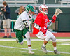 Baldwinsville Bees Ryan Gebhardt (20) with the ball against working against a Fayetteville-Manlius Hornets defender in Section III Boys Lacrosse action at the Fayetteville-Manlius High School in Manlius, New York on Wednesday, May 18, 2016.  Fayetteville-Manlius won 9-8.