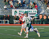 Fayetteville-Manlius Hornets Tommy Angelicola (13) with the ball against the Baldwinsville Bees in Section III Boys Lacrosse action at the Fayetteville-Manlius High School in Manlius, New York on Wednesday, May 18, 2016.  Fayetteville-Manlius won 9-8.