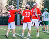 Baldwinsville Bees Ryan Gebhardt (20) gets congratulated by Connor Smith (26) and Peter Fiorni III (13) on his goal agianst the Fayetteville-Manlius Hornets in Section III Boys Lacrosse action at the Fayetteville-Manlius High School in Manlius, New York on Wednesday, May 18, 2016.  Fayetteville-Manlius won 9-8.