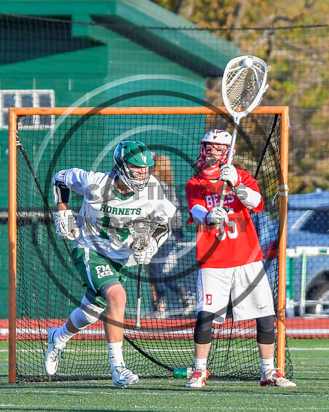 Baldwinsville Bees goalie Riley Smith (35) sends the ball up field against the Fayetteville-Manlius Hornets in Section III Boys Lacrosse action at the Fayetteville-Manlius High School in Manlius, New York on Wednesday, May 18, 2016.  Fayetteville-Manlius won 9-8.