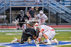 Baldwinsville Bees Evan Stolicker (32) facing off agianst Syracuse Cougars Jakev Jackson (7) in Section III Boys Lacrosse Semi-Finals action at the Bragman Stadium in Cicero, New York on Thursday, May 26, 2016.  Baldwinsville won 16-5.