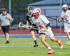 Baldwinsville Bees #36 with the ball against the Syracuse Cougars in Section III Boys Lacrosse Semi-Finals action at the Bragman Stadium in Cicero, New York on Thursday, May 26, 2016.  Baldwinsville won 16-5.