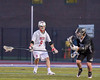 Baldwinsville Bees Josh Stanton (9) defending against Syracuse Cougars Matt Eccles (11) in Section III Boys Lacrosse Semi-Finals action at the Bragman Stadium in Cicero, New York on Thursday, May 26, 2016.  Baldwinsville won 16-5.