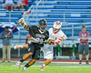 Baldwinsville Bees Greg Norton (8) defending against Syracuse Cougars Mike McLeod (29) in Section III Boys Lacrosse Semi-Finals action at the Bragman Stadium in Cicero, New York on Thursday, May 26, 2016.  Baldwinsville won 16-5.