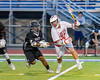Baldwinsville Bees Evan Stolicker (32) protecting the ball from Syracuse Cougars defender Mike McLoed (29) in Section III Boys Lacrosse Semi-Finals action at the Bragman Stadium in Cicero, New York on Thursday, May 26, 2016.  Baldwinsville won 16-5.