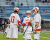 Baldwinsville Bees Peter Fiorni III (13), Ryan Gebhardt (20) and Charlie Bertrand (6) talk during a stoppage of play agianst the Syracuse Cougars in Section III Boys Lacrosse Semi-Finals action at the Bragman Stadium in Cicero, New York on Thursday, May 26, 2016.  Baldwinsville won 16-5.
