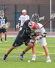 Baldwinsville Bees Ryan ingerson (3) gets checked by Syracuse Cougars Ben Boggans (9) in Section III Boys Lacrosse Semi-Finals action at the Bragman Stadium in Cicero, New York on Thursday, May 26, 2016.  Baldwinsville won 16-5.