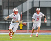 Baldwinsville Bees Ben Dwyer (5)  and Kyle Pelcher (29) track the ball agianst the Syracuse Cougars in Section III Boys Lacrosse Semi-Finals action at the Bragman Stadium in Cicero, New York on Thursday, May 26, 2016.  Baldwinsville won 16-5.