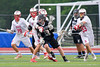 Baldwinsville Bees Matt Dickman (23) strips the ball from Syracuse Cougars Matt Eccles (11) in Section III Boys Lacrosse Semi-Finals action at the Bragman Stadium in Cicero, New York on Thursday, May 26, 2016.  Baldwinsville won 16-5.